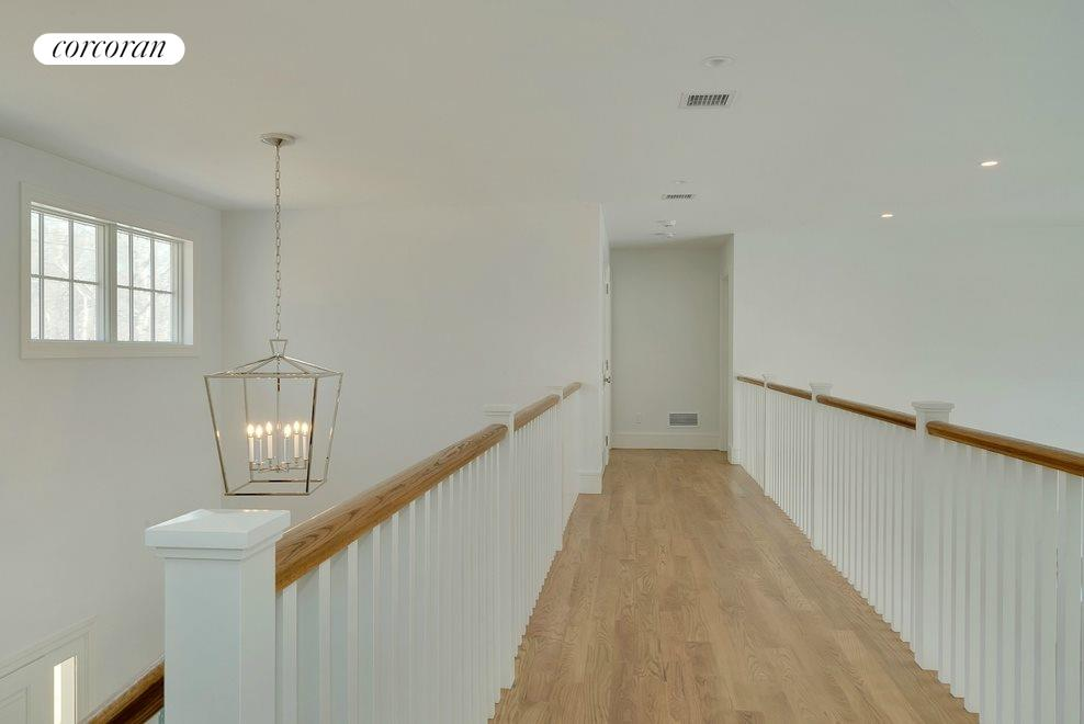 Catwalk spanning entryway and living area