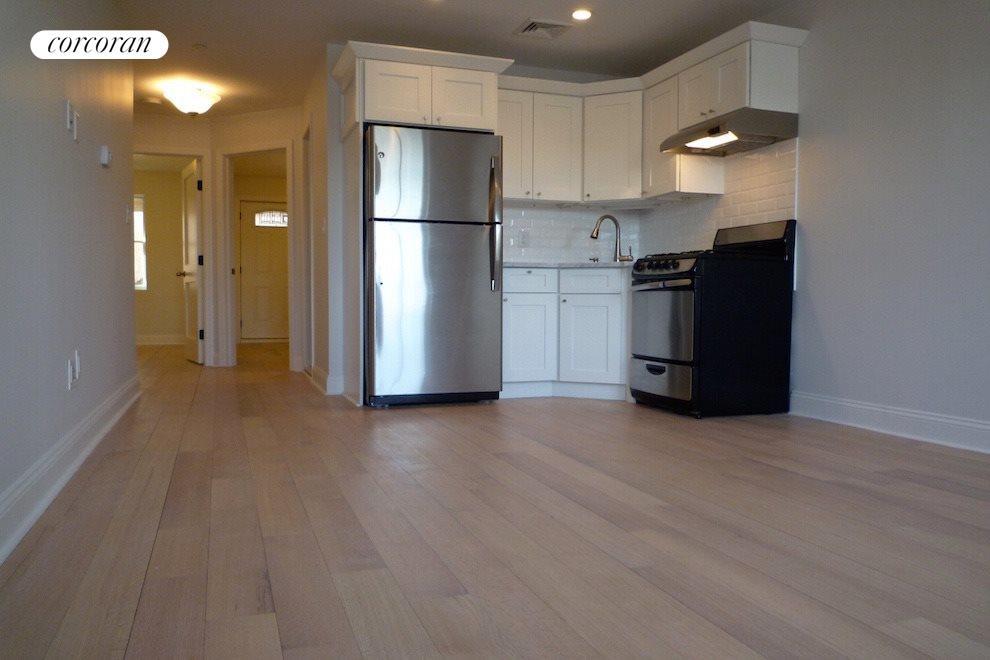 Open Kitchen w/ Stainless Steel Appliances