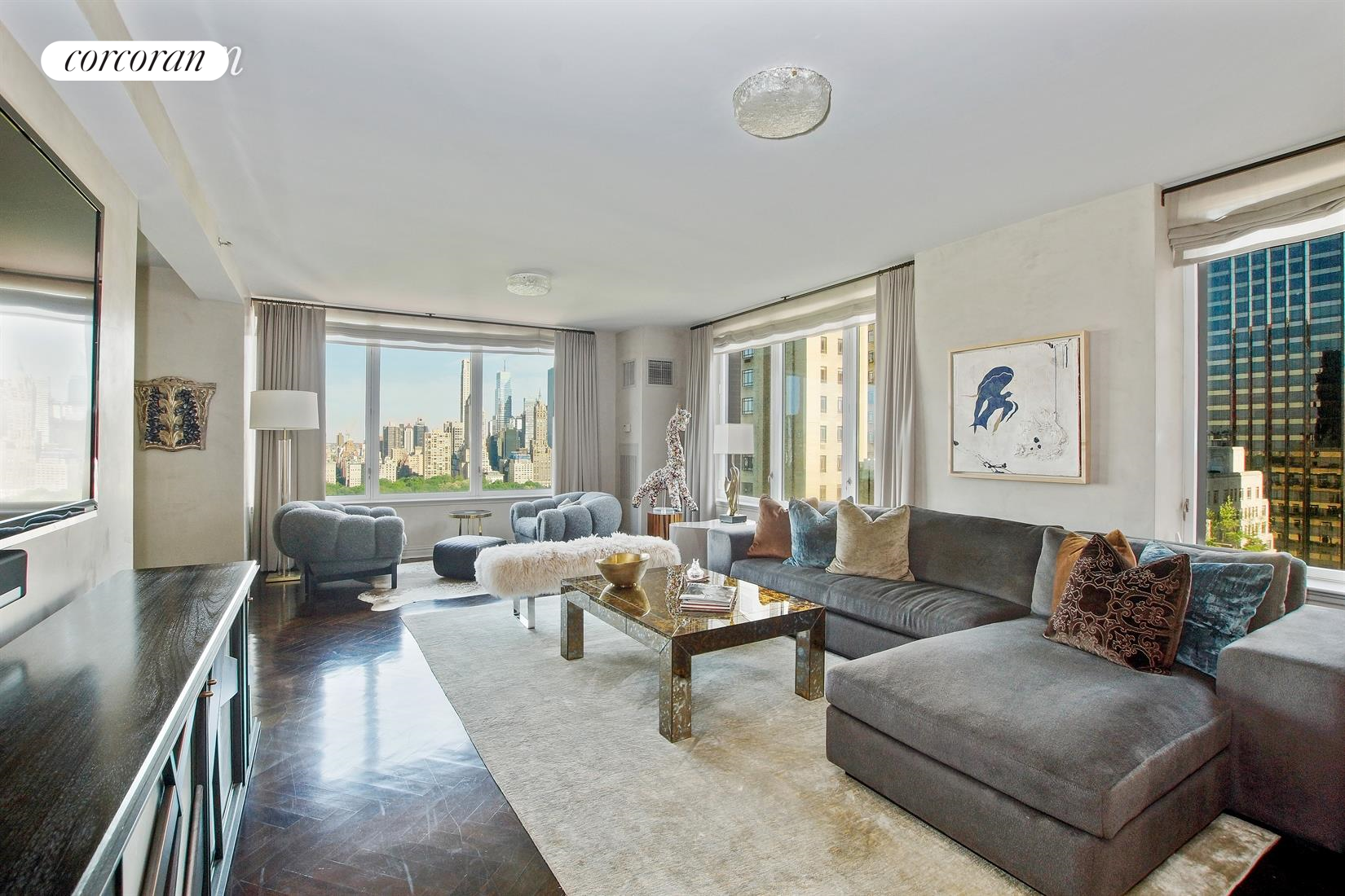 Breathtaking views of Central Park views from this 4 bedroom/4.5 bath home at the Park Laurel.  Entering into an elegant gallery, this stunning and spacious home is sun-drenched with eastern, southern, and northern exposures. The corner living room and dining room are ideal for entertaining.  The floors are handsomely stained dark herringbone, the living room, dining room, and gallery walls are enhanced with Venetian plaster walls.  The eat-in kitchen is well equipped with high end kitchen appliances including Subzero refrigerator, Thermador oven and range, Miele dishwasher, and large pantry adjacent to the kitchen, and powder room.  The master suite features central park views, outfitted closets, and en-suite bath with separate shower. The additional 3 bedrooms all have en-suite baths.  Additional enhancements include Sonos wireless sound in the living room, dining room, and master bedroom. The Park Laurel is a full service, doorman/concierge condominium with fitness room, garage, bike room, playroom.