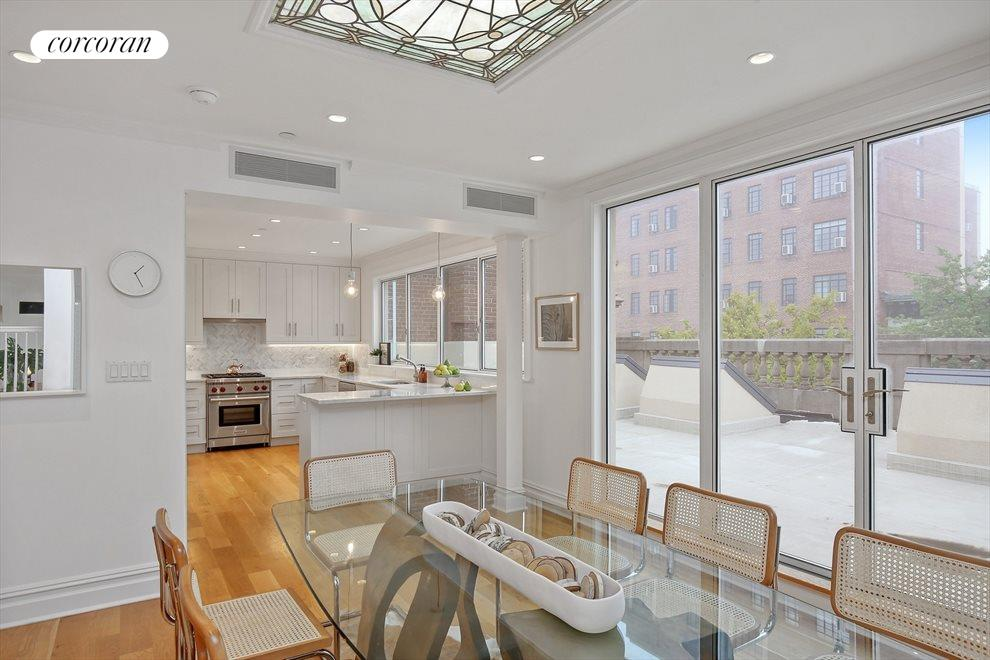 Kitchen and Dining with Sliding Doors to Terrace