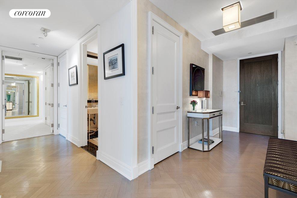Large entry foyer with herringbone floors