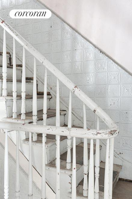 Original tin wainscoting and original banister