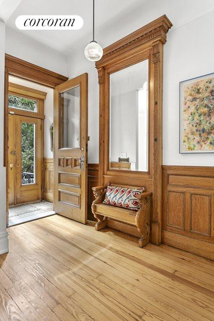 Welcoming entry foyer with large coat closet