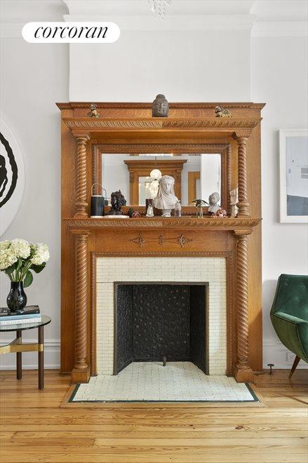 Original, ornate wood mantle