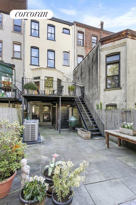 Rear facade, deck, and yard