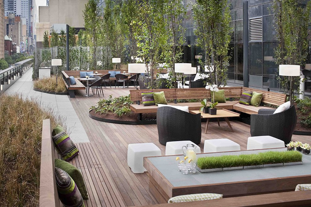 Lush terrace & deck with BBQ grills.