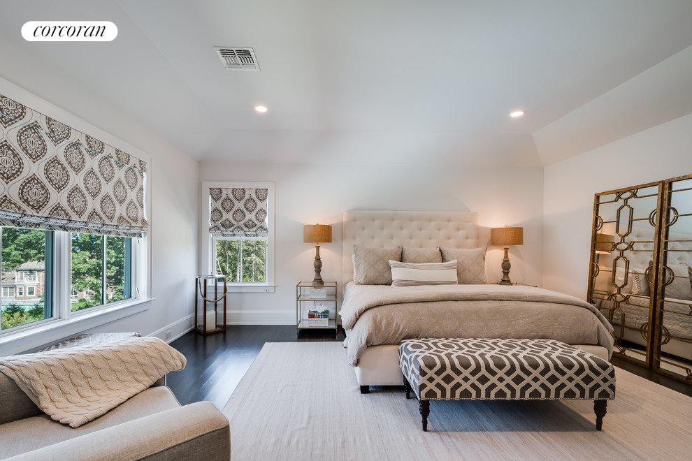 Roomy master suite overlooks the pretty yard