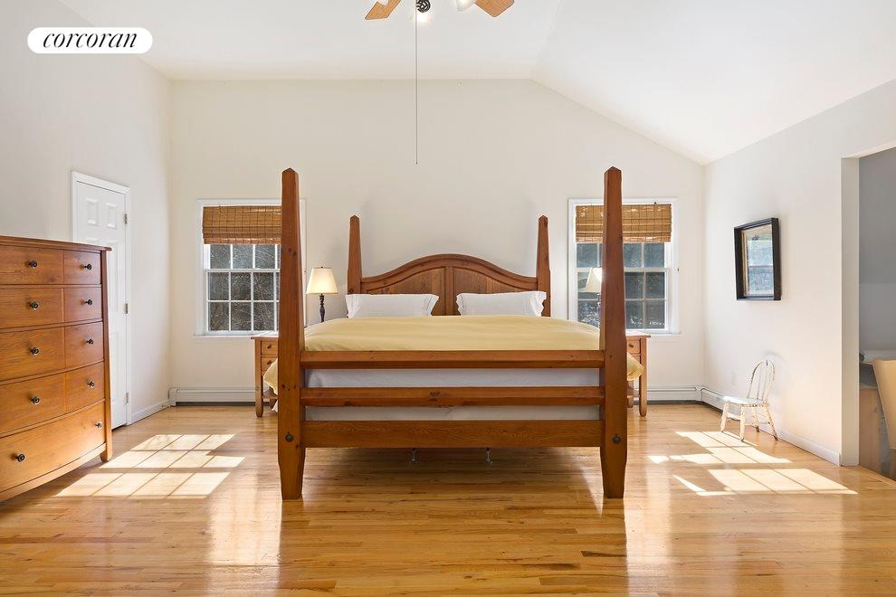 Master suite has vaulted ceilings and sitting area