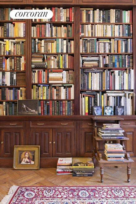 A wall of built-in bookcases and cabnetry.